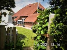 Fotos vom  Ferienhaus Kolks Huus in Carolinensiel Harlesiel zeigen die vielen Möglichkeiten, die das Haus mit Gartengrill, Hochterrasse, dem herrlichen Garten und der hochwertig ausgestatteten Terrasse dem Feriengast bietet für einfach schöne Ferien an der Nordsee